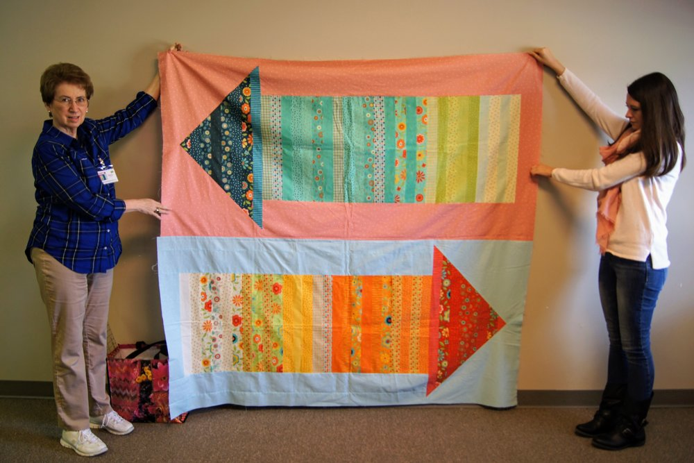 Theresa Kitchell (left) and her arrows quilt top
