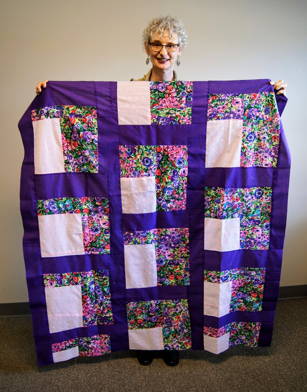 Denise Ohlman re-pieced an old quilt with non-traditional fabrics.