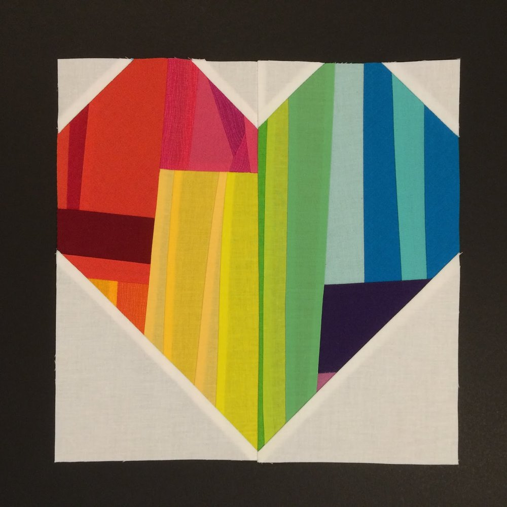 A heart block made by Kelly Spell for #quiltsforpulse.