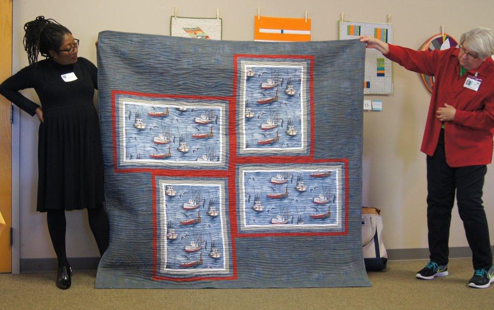 Quilt by Carolyn Pugh (left)