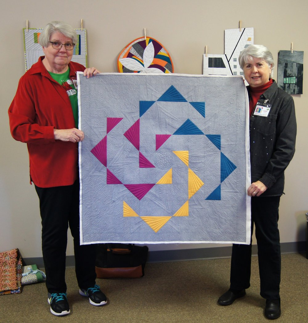 Jean Larson (left) pieced this top and it was quilted by Carolyn Rippee (right)