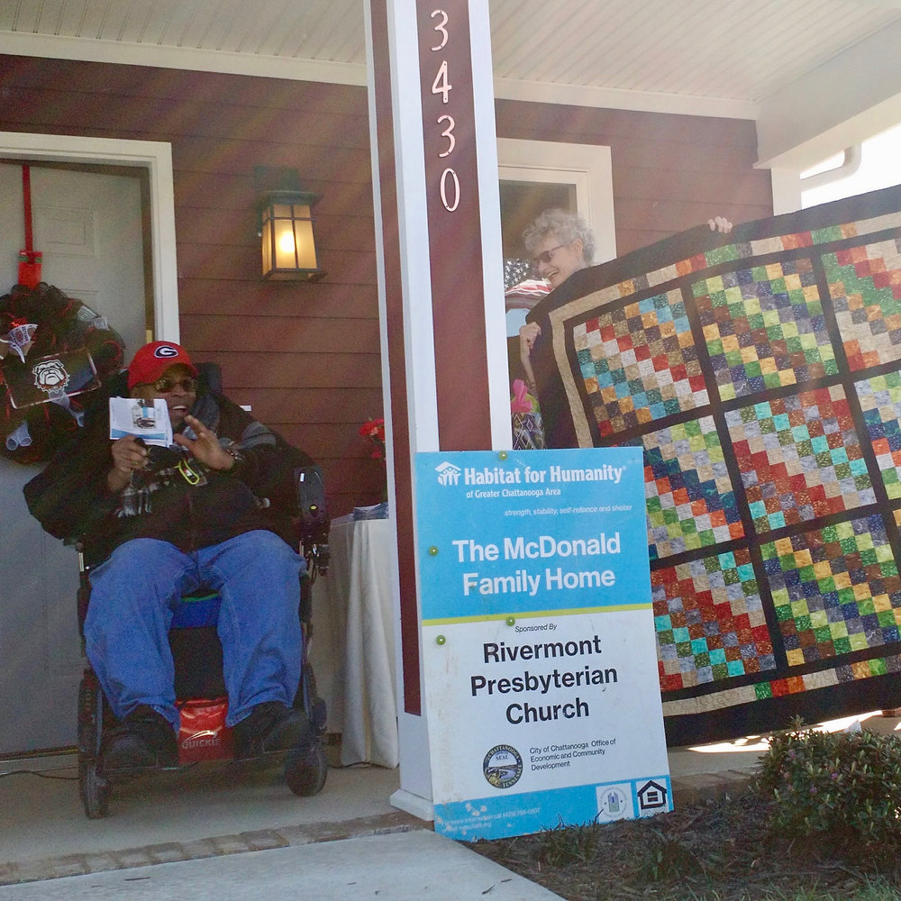 Sidney McDonald (left) received a quilt and the keys to his new house March 3. Photo courtesy of Habitat for Humanity of Greater Chattanooga.