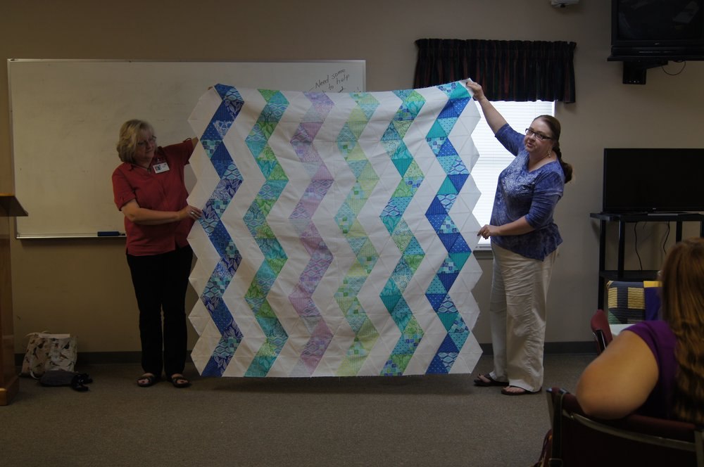Zigzag quilt top by Ava Moore (right)
