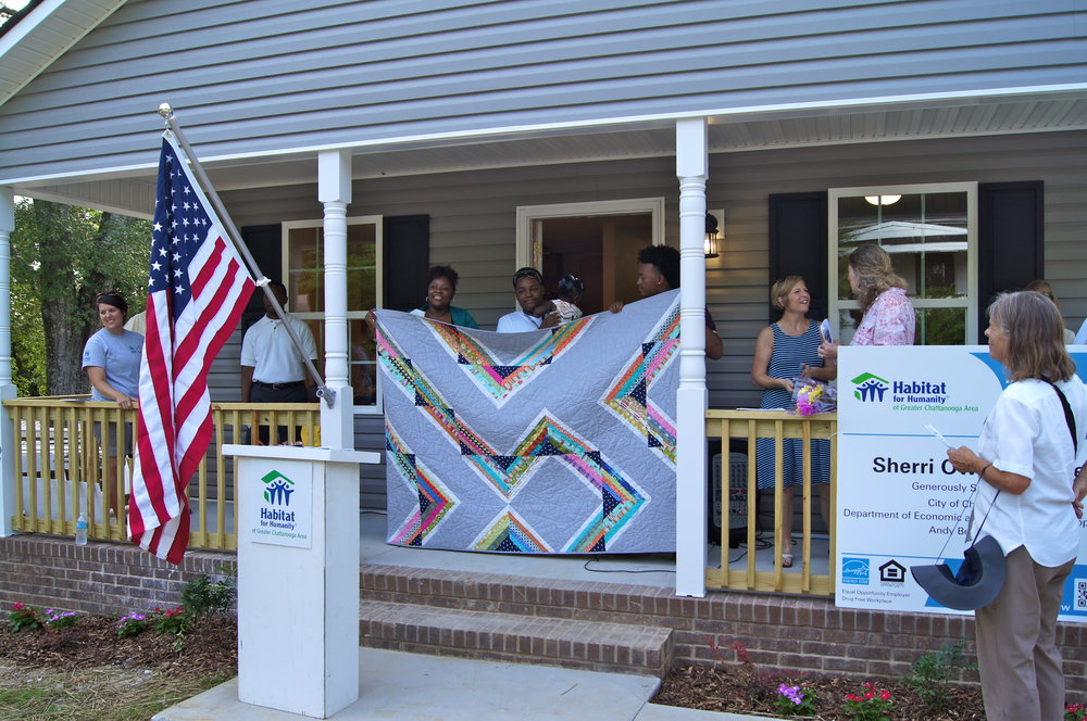 The Owens family and their quilt.Photo courtesy of Habitat of Humanity of Greater Chattanooga.