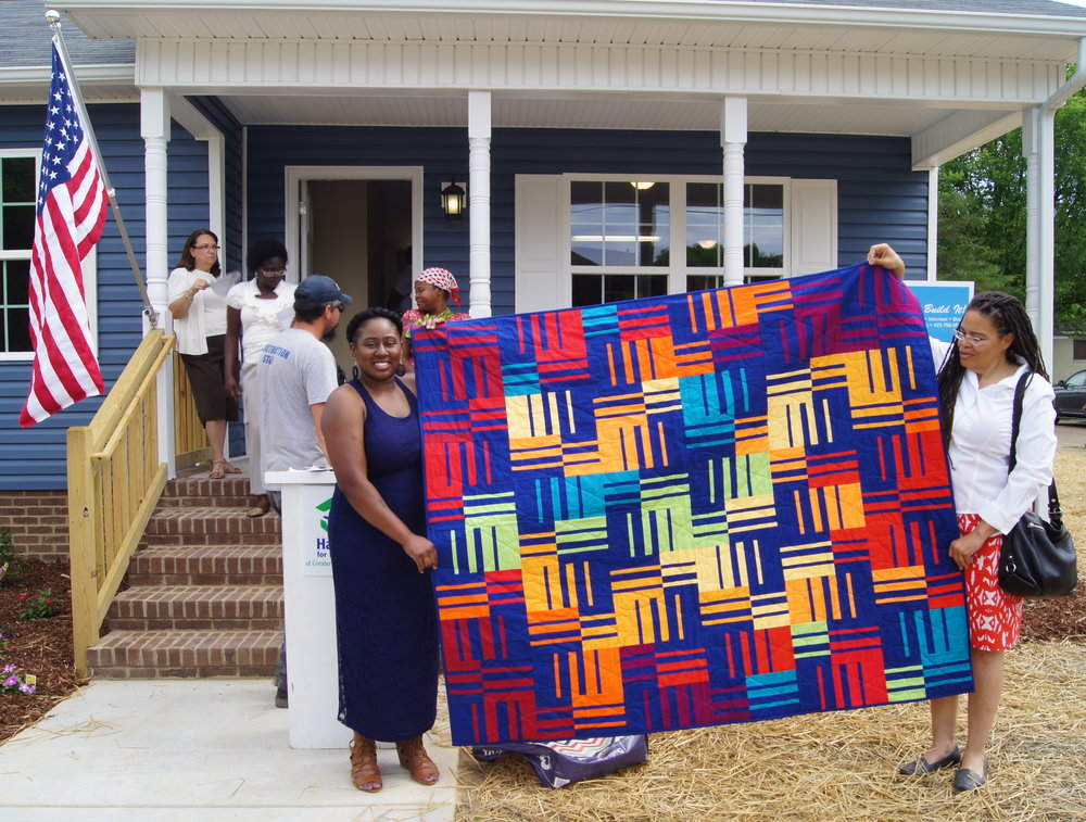 Torri Scott (left) received the knee socks quilt. Photo courtesy of Habitat of Humanity of Greater Chattanooga.