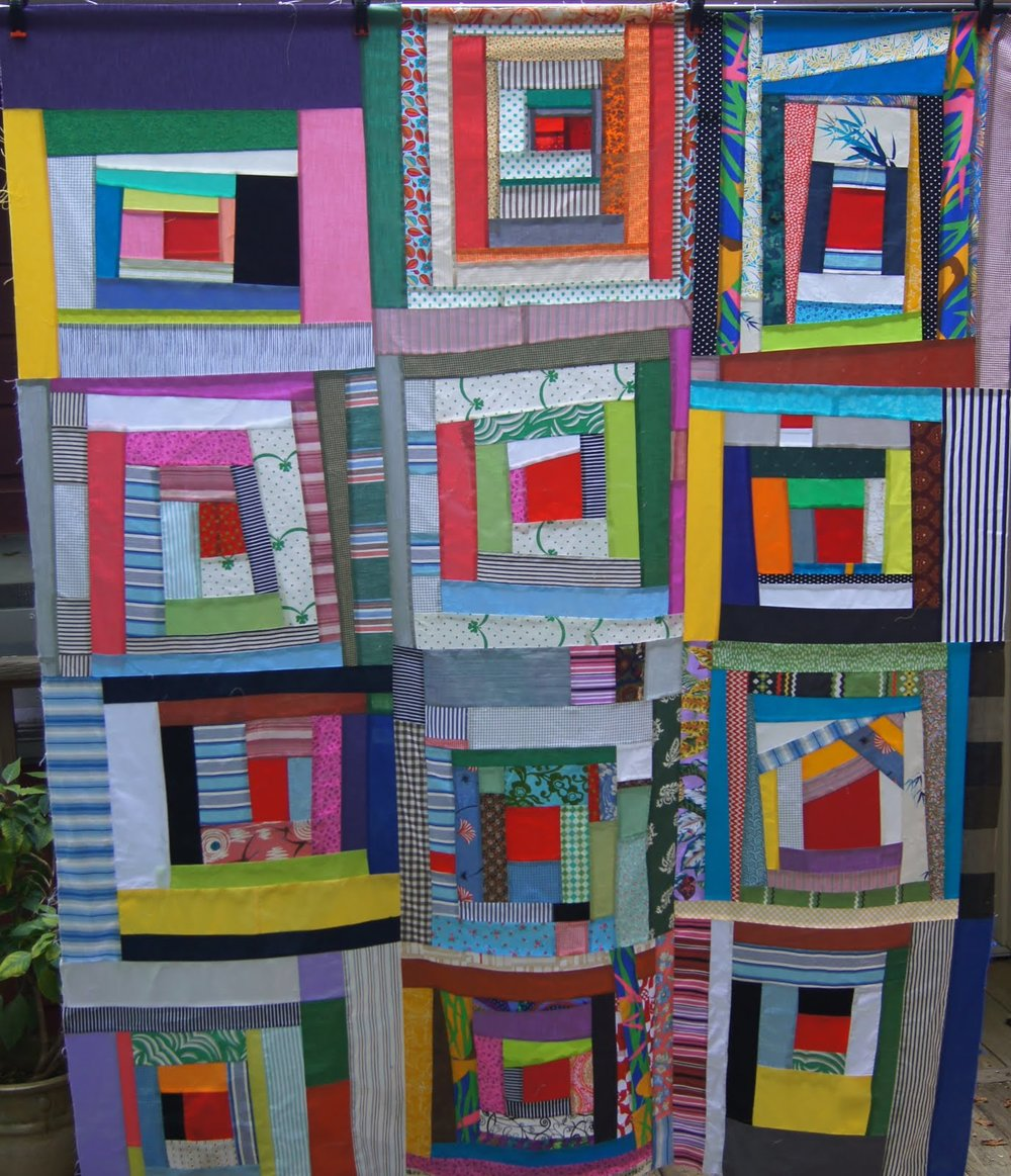 Audrey Workman pieced this quilt top using members' blocks.