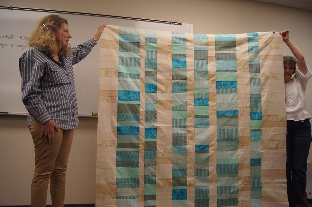 Quilt top by Shirley Prince (left)