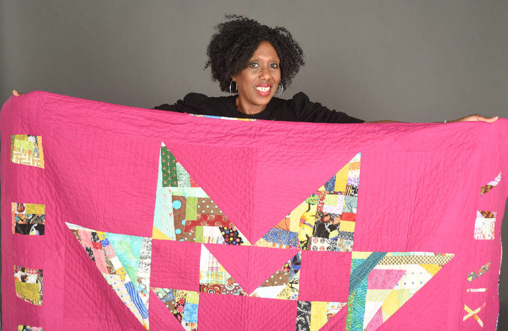 Cornelia Johnson with her quilt. Photo courtesy The Times-Free Press.
