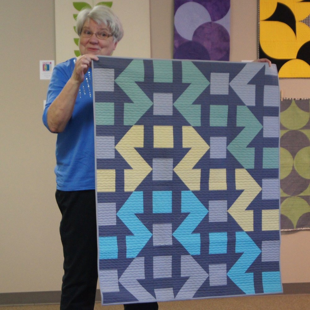 Modern churn dash quilt by Jean Larson