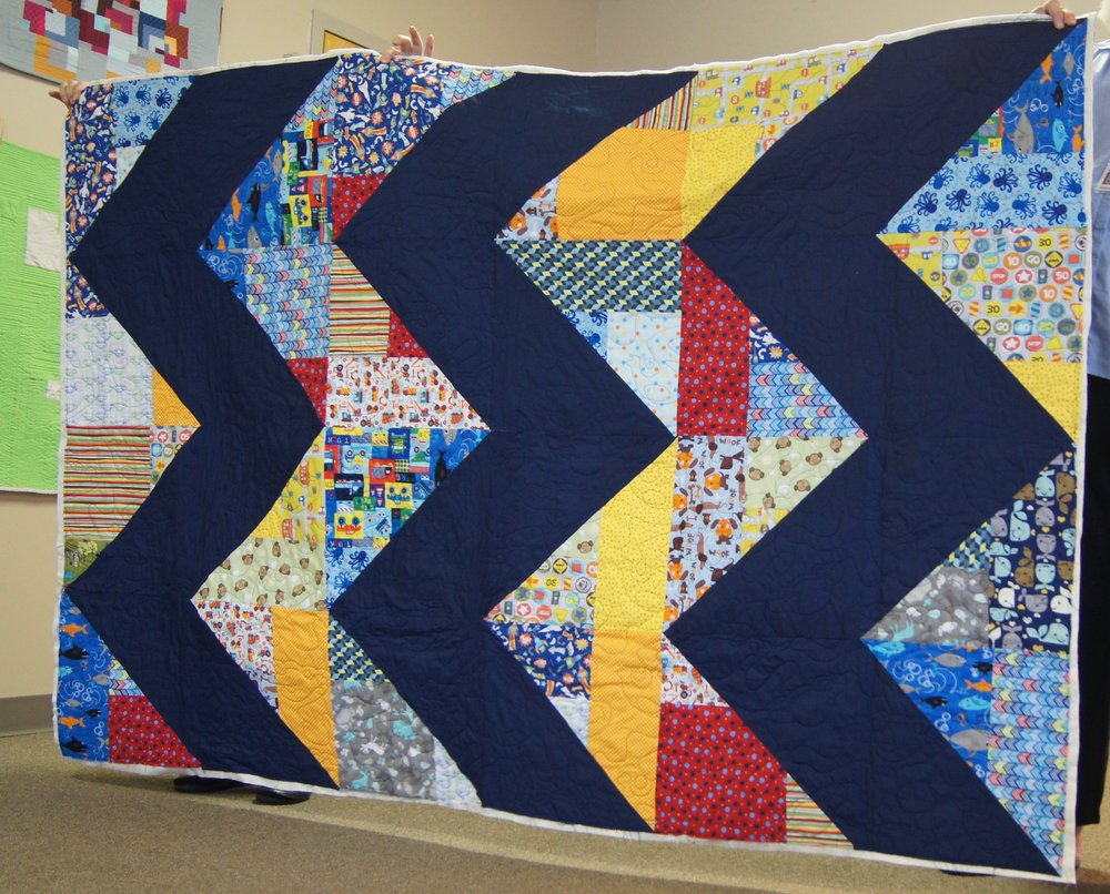 Zig zag baby quilt by Ashley Brown