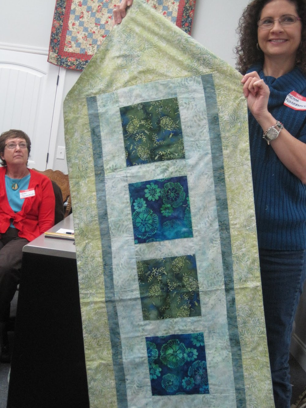 Tablecloth by Melissa Klingensmith (right)