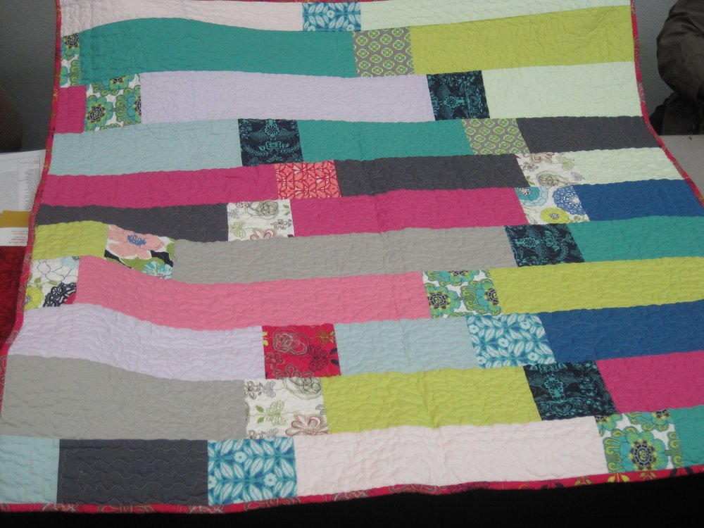 Janet Suber's quilt has a modern backing!