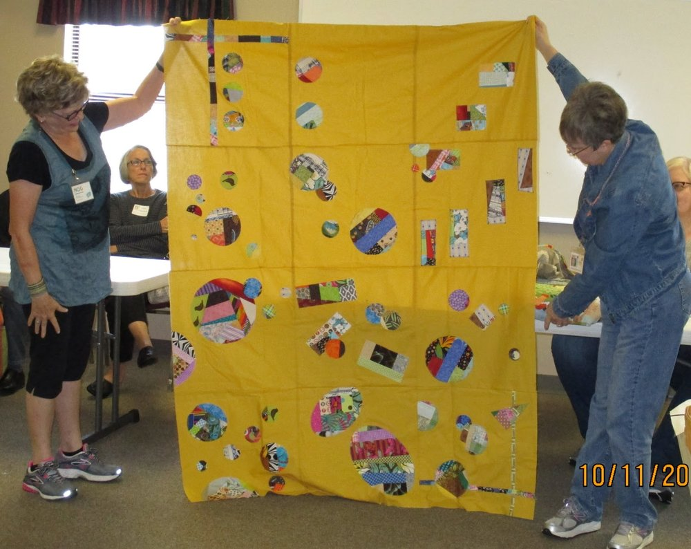 Ann (left) and Patricia (right) show off Team Sandi's quilt top