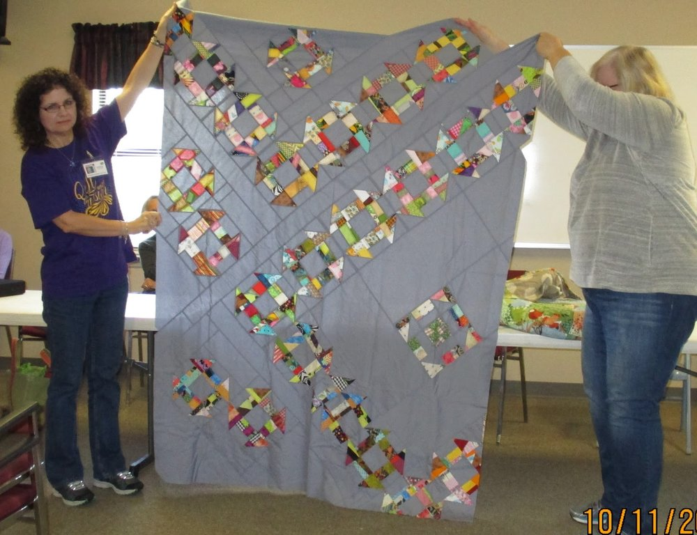 Melissa (left) and Janet (right) show off Team Janet's quilt top