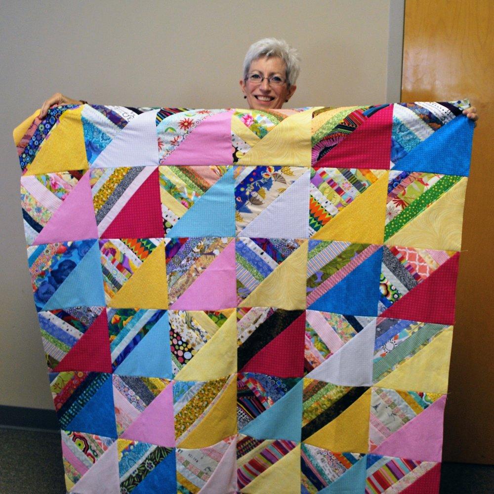 Scrappy strip quilt top by Patti Ann Smith