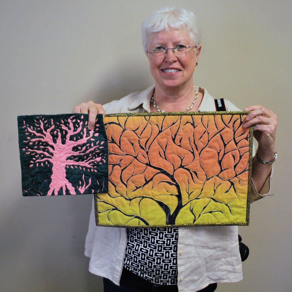 Reverse appliqué trees by Martha Steele