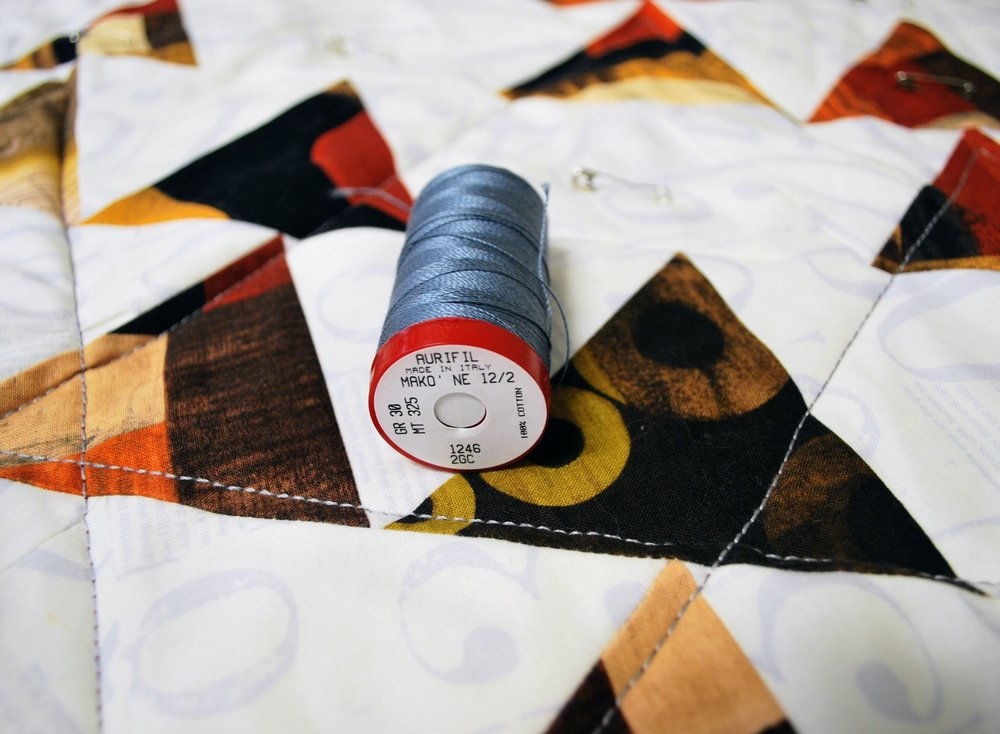 To mimic the look of hand quilting with your sewing machine, try a thicker thread such as Aurifil's 12wt cotton.