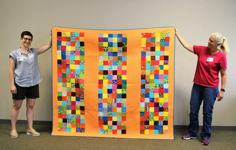 Kelly Spell (left) quilted this Habitat quilt, which was pieced by Sara Bradshaw (right)