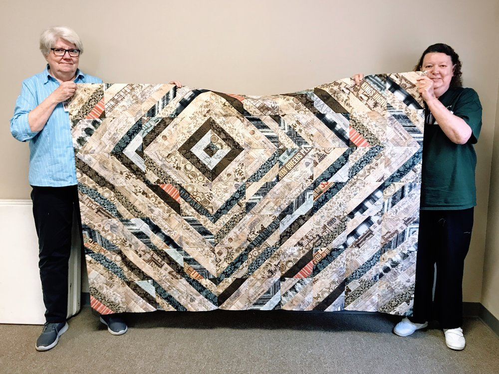 Quilt top by Beverly Herron (right) with help from Jean Larson (left)
