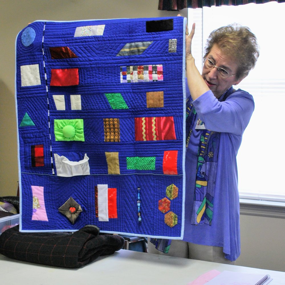 Theresa used a variety of materials to create this tactile sensory quilt for her neighbor.