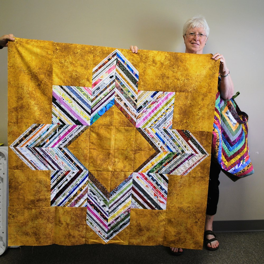 Selvage strip quilt top by Martha Steele