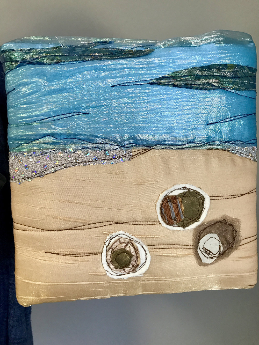 Mounted wall hanging by Donna Rand