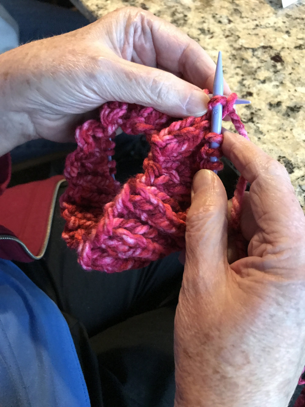 Jean was working her knitting needles