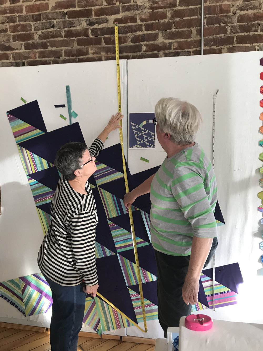 Mary and Jean determine the desired height of the quilt.