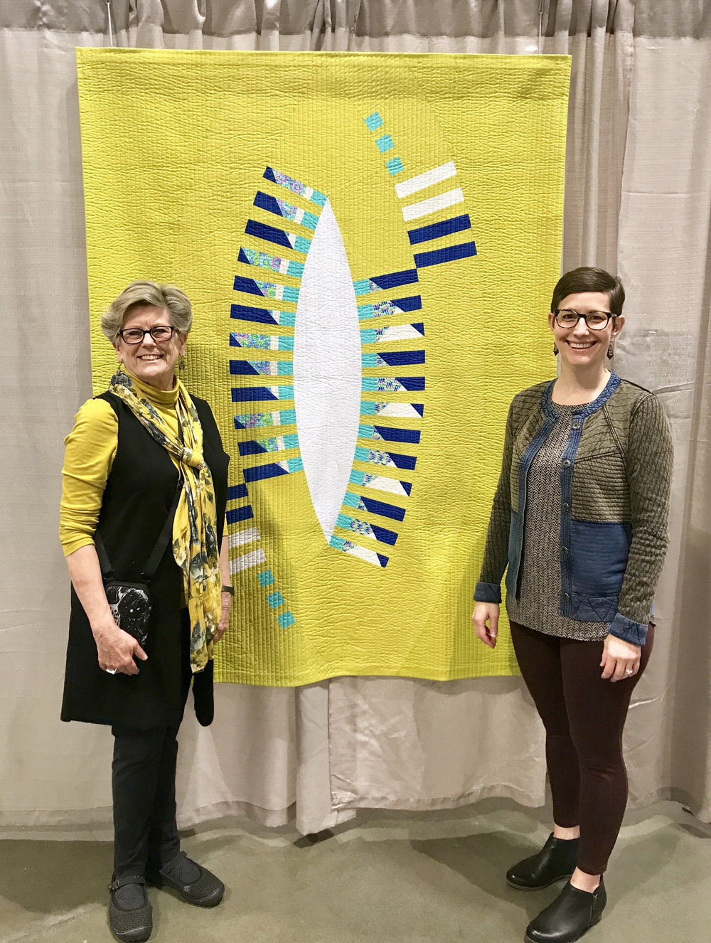 "Ann Hurley (left) and Kelly Spell (right) with Kelly's quilt ""Felicitous Pickle"""