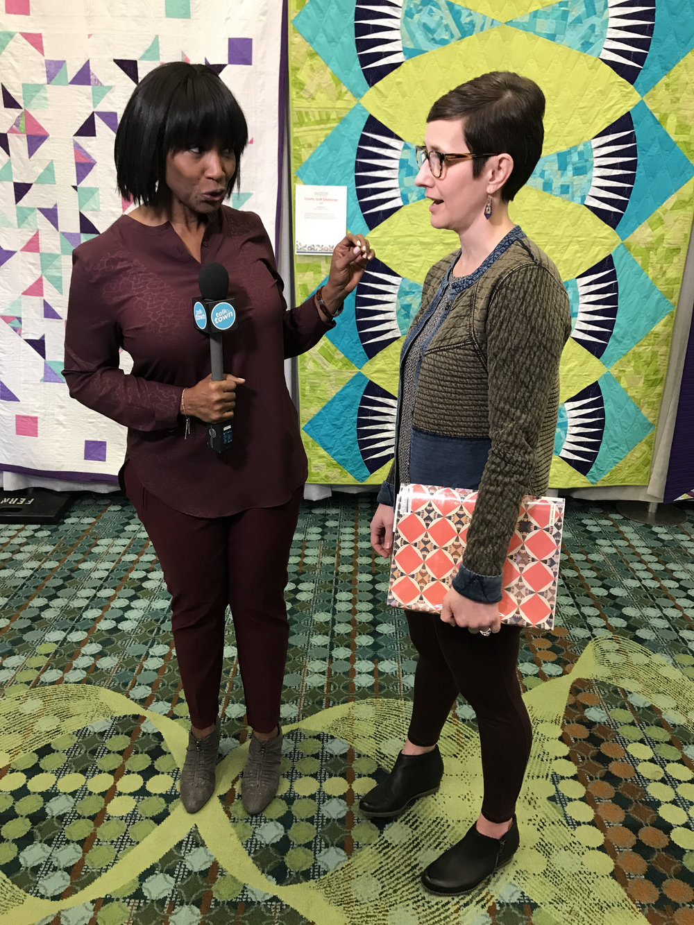 Kelly was interviewed by a local news station about our modern basket quilt