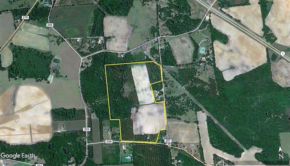 Aerial _ 82 Ac. Hay, Timber & Home.jpg