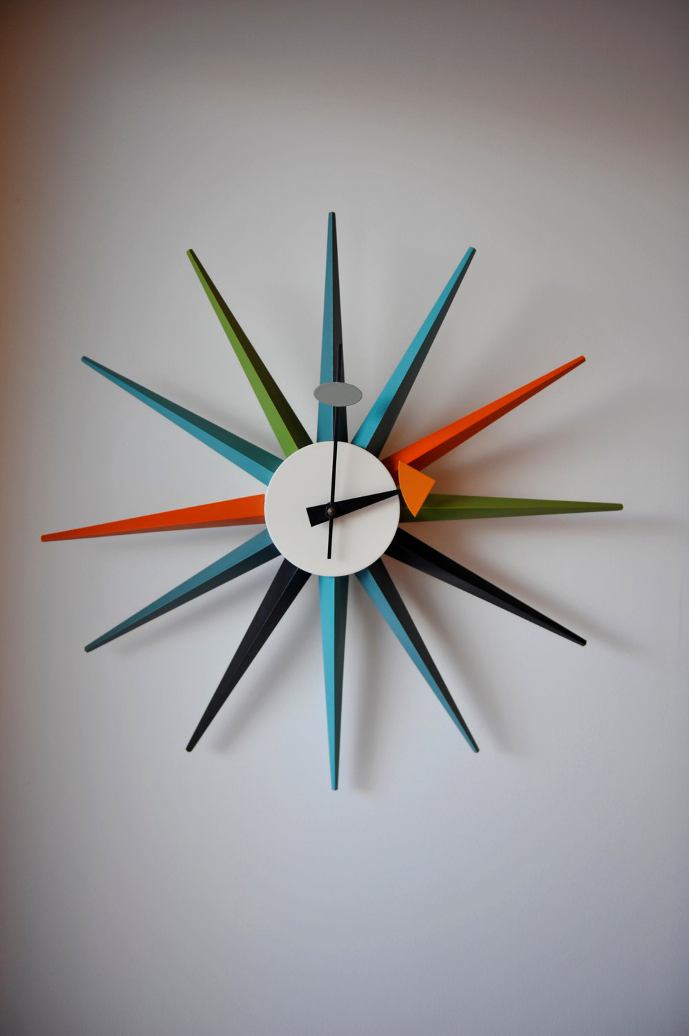 colorful mid-century nelson clock on wall
