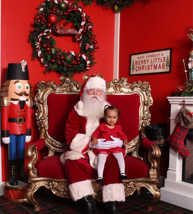 little ruby met santa last night she did great i cant believe it i wouldnt say she loves santa but she didnt freak out either - Christmas Pictures With Santa 2