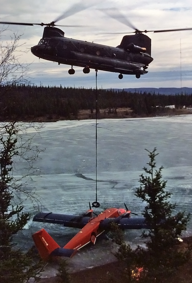 Placement of aircraft on shoreline in preparation to be moved to Yellowknife by sling load