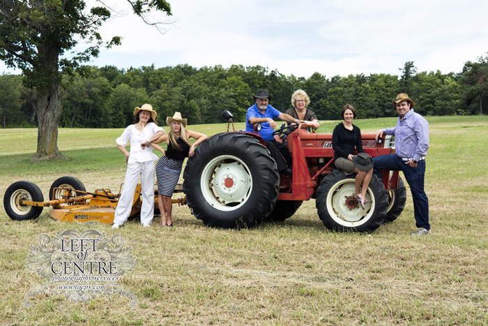 Family grouping sitting on a tractor