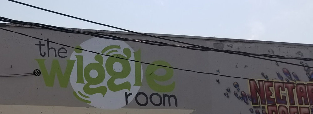 The Wiggle Room Logo on the Building