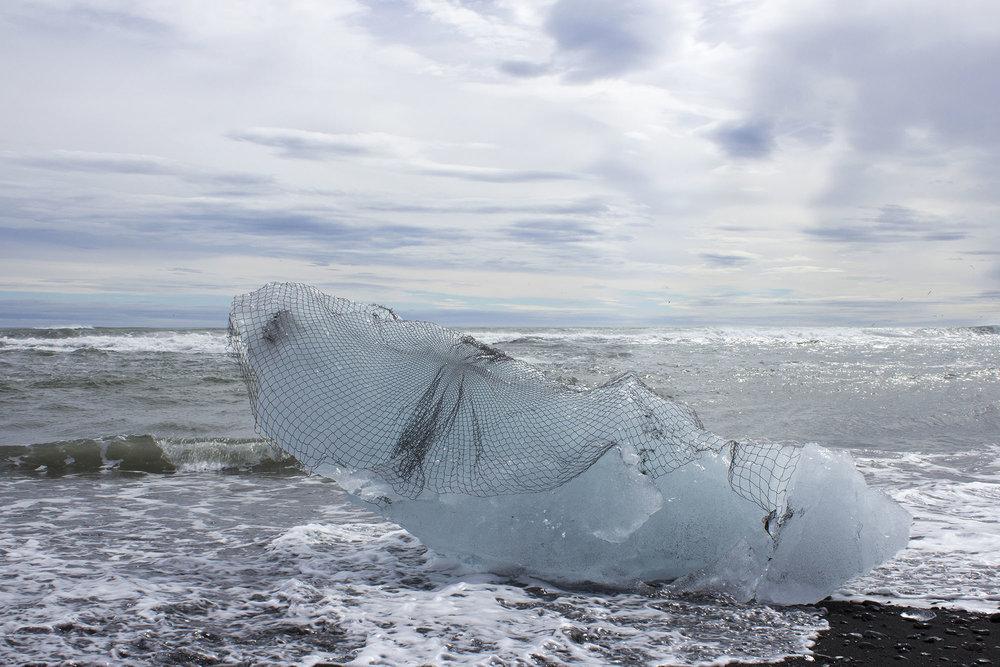 to reinforce a glacier  ,2017 hand-beaded net, calved iceberg site-responsive installation  Breiðamerkurjökull, Vatnajökull, Iceland