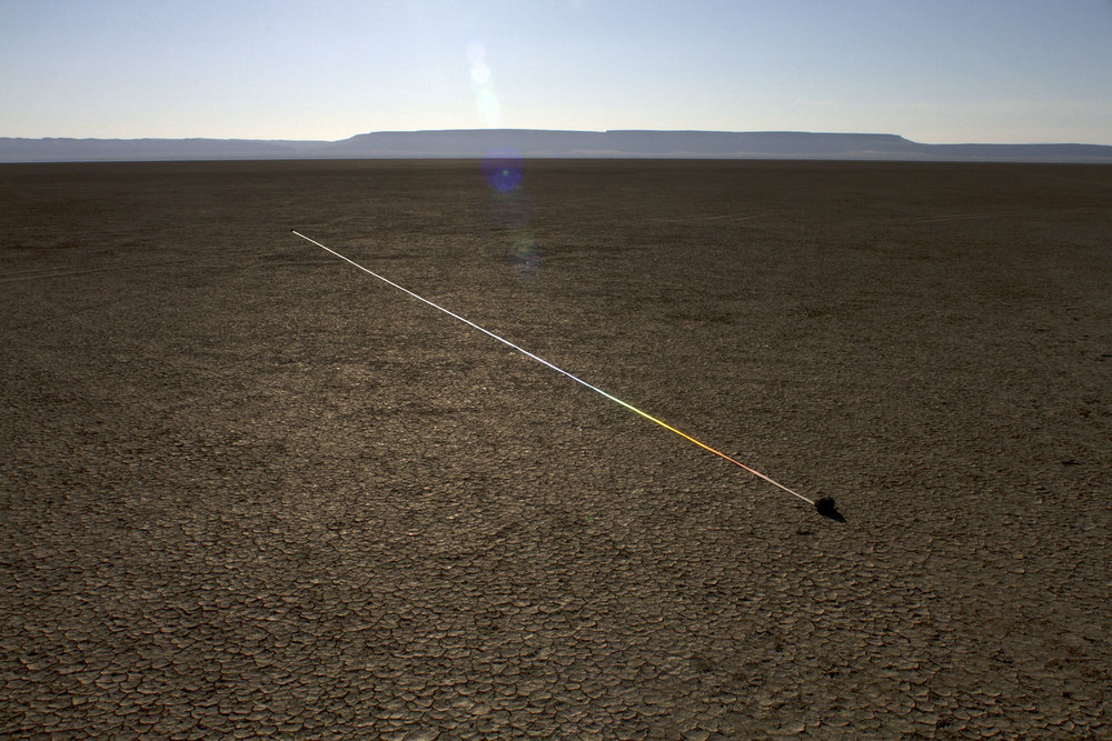 marking time in light  , 2014 reflective fabric tape, found stones, natural light 8.5 x 1.5 x 1494 in. image credit |  Ian Clark   Alvord Desert, Eastern Oregon