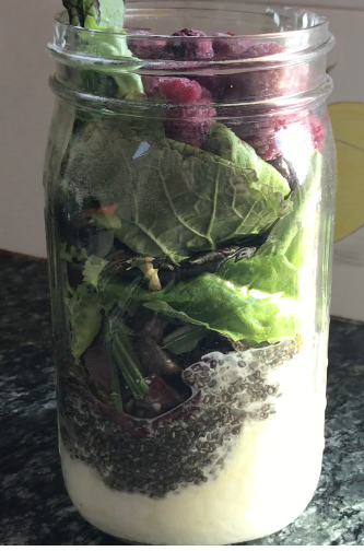 My smoothie with 2 TBSP chia seeds, 1/2 cup of whole-fat, plain yogurt, 2 scoops of collagen powder, 2 cups of leafy greens, 1/2 cup of raspberries, 1/4 banana, 1 TBSP of Bulletproof Brain Octane MCT Oil, and some water and ice.