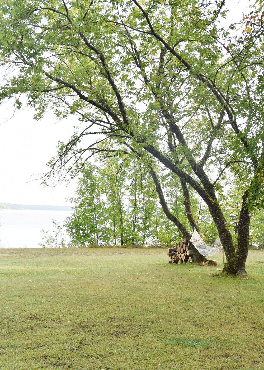 hammock hanging between trees with view of nutimik lake