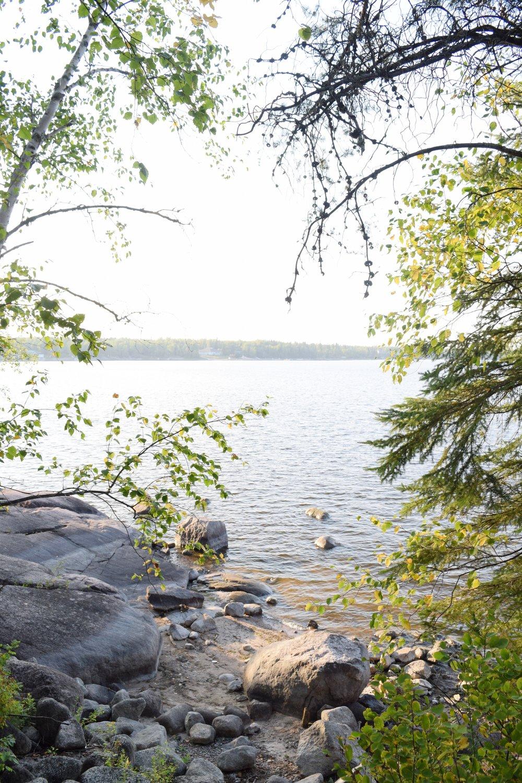 view across nutimik lake through the trees