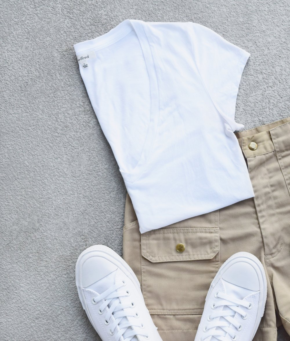 wilfred t-shirt woolrich shorts and all white converse