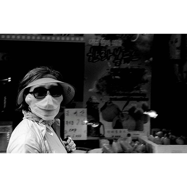 Ajjuma in full battle rattle. Seoul, South Korea.  2017 #35mm #andthelastwaves #myendlessproof #ourstreets #capturestreets #hp5pushed2stops #shootfilmstaybroke #shootfilmnotmegapixels #analog #filmphotography #filmsnotdead #leicam3 #leica #filmlovephotography #develop #doyoudevelop #wasteoffilm #deathb4digital #photofilmy #allformatcollective #korea #misfitgrain #polyesterbase #burnmyeye #burndiary #burnmagazine #streetsacademy