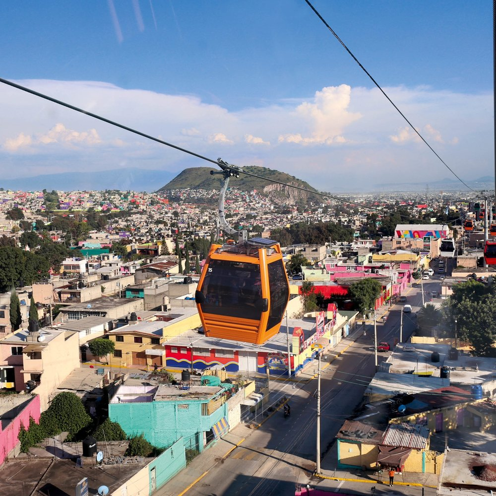 Overhead Cable Cars - An overhead cable car could be built for around £35million, which is relatively low cost, and with minimum disruption or infrastructure requirements. This would be a tourist attraction for Hereford as well as a safe, quick and practical way to ferry commuters to school and work. Three cable cars could be constructed for half the price of the Bypass! Mexico city has really benefited from this. The cable cars there took only a short time to build, had minimal impact on the local environment and they are really popular with everyone as they are safe and cheap to use and run.Mexico city (left) has put in overhead cable cars to reduce congestion, get people to work faster and more safely.Photo: LEITNER ropewaysClick Photo for Video
