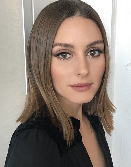 Olivia Palermo - Olivia's stylist Matt Fugate created this look using Kerastase products and a low heat flat iron, he used Laque Courture and Elixir Ultime to created this look.