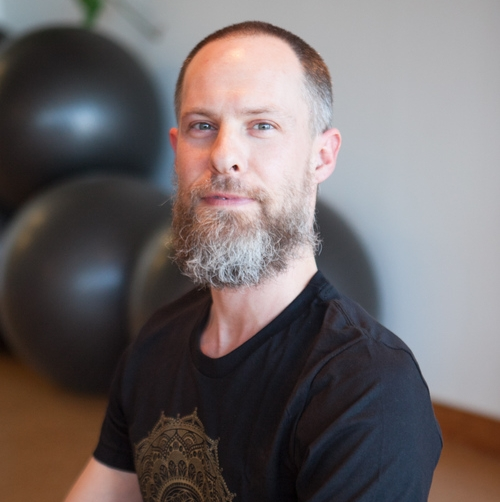 """Wes Pilcher Wes Pilcher is a teacher and co-owner of the Arkansas Yoga Collective in Little Rock, Arkansas.His teaching style comes from a unique combination of training in the Dynamic Yoga Method with Matthew and Holly Krepps and Duncan Wong. Wes also studied holistic healing through Clayton College of Natural Medicine and studied Ayurveda with Dr. Champa.Wes is co-owner of the Arkansas Yoga Collective, teaching there, at the Jim Dailey fitness center and Bigrock Yoga in Little Rock, Arkansas. Wes also produced and developed a video, """"Satellite Flow"""", a Vinyasa or flowing series based on his unique style.He encourages students to challenge themselves while maintaining an atmosphere of lightheartedness that allows students to practice, experiment, laugh and grow."""