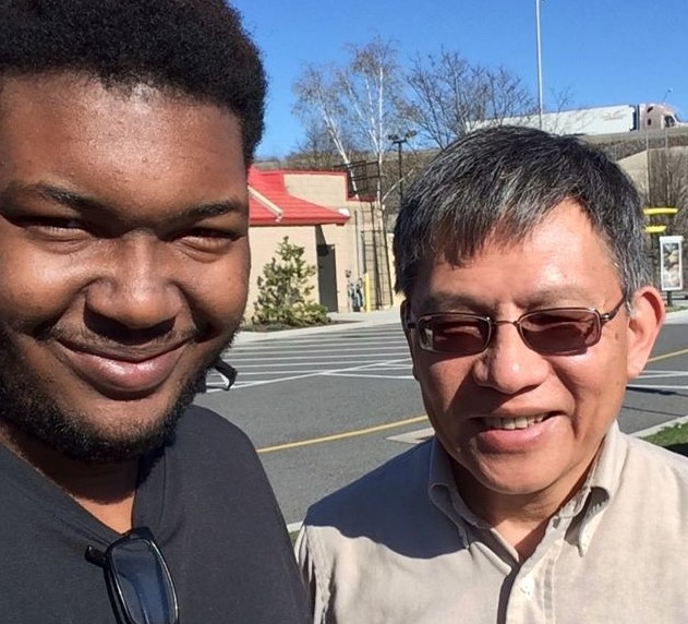 Neil Tan, with his mentee Dwayne.