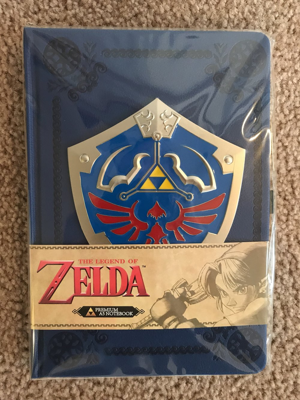 Hylian Shield on the cover of the notebook