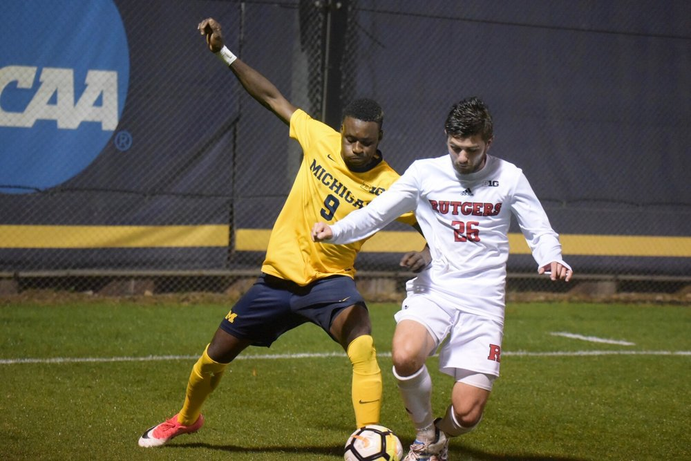 Mohammed Zakyi (9) tied a Michigan single match record with 3 assists on Friday