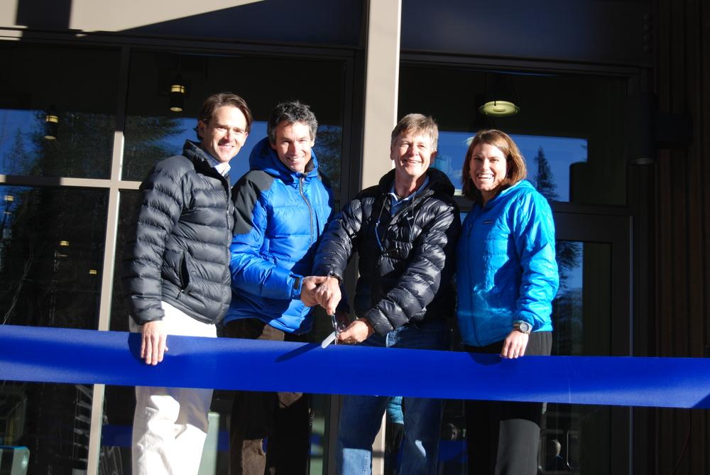 John Hommeyer, Bill Hudson, Jim Harleen, and Tracy Keller cut the ribbon at the entrance to SBA's new academic building.